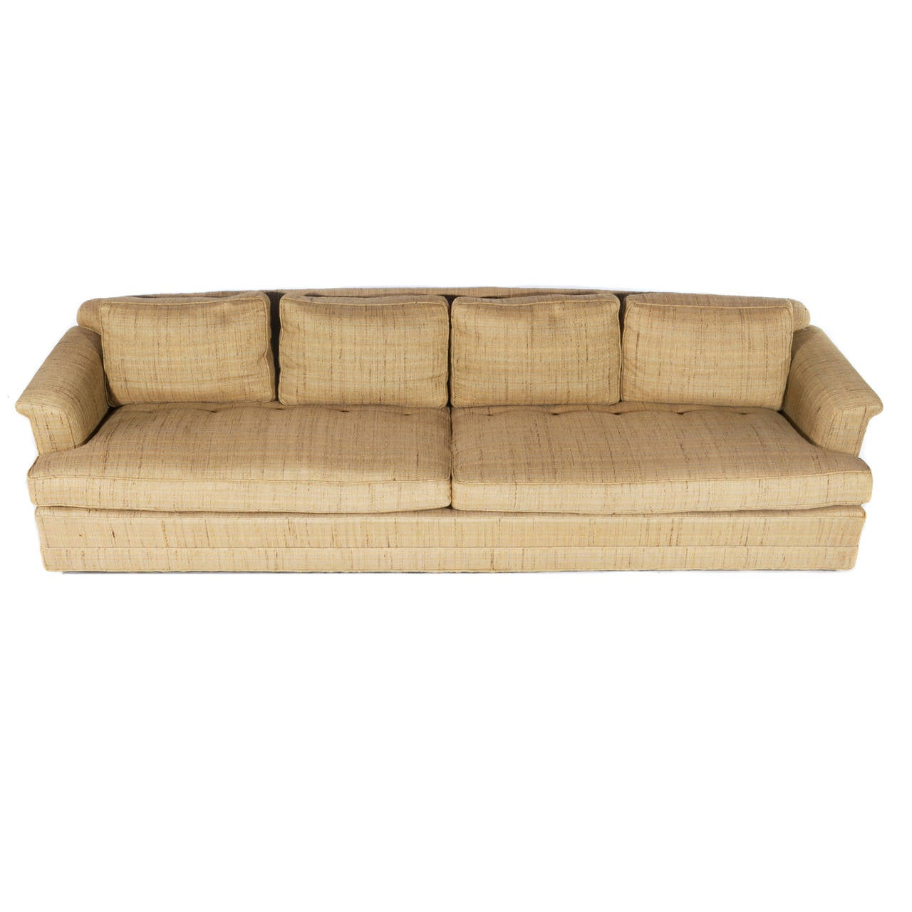 Classic Dunbar form with down-stuffed seat and back cushions. Raised on casters. Large, deep and comfortable, with high-quality Dunbar construction. Signed Dunbar in decking. Measure: Arms are 21-1/2
