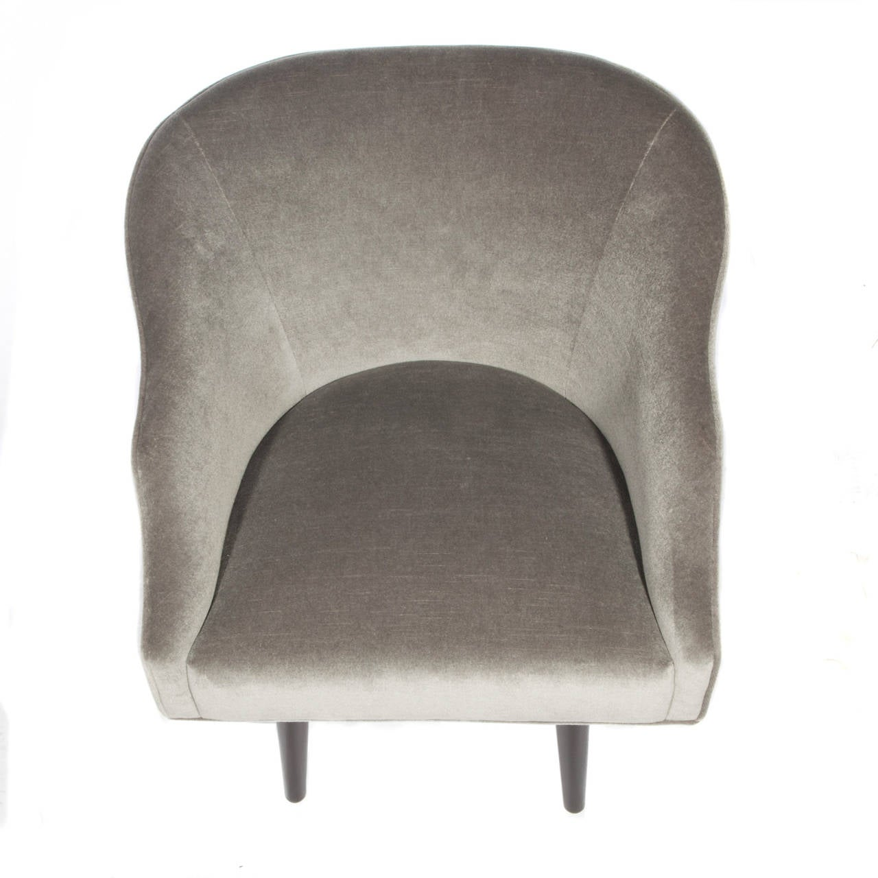 Elegant pair of 1960s armchairs with sculptural, integrated arms, reupholstered in a rich grey mohair. Swivel and return mechanism. Gold