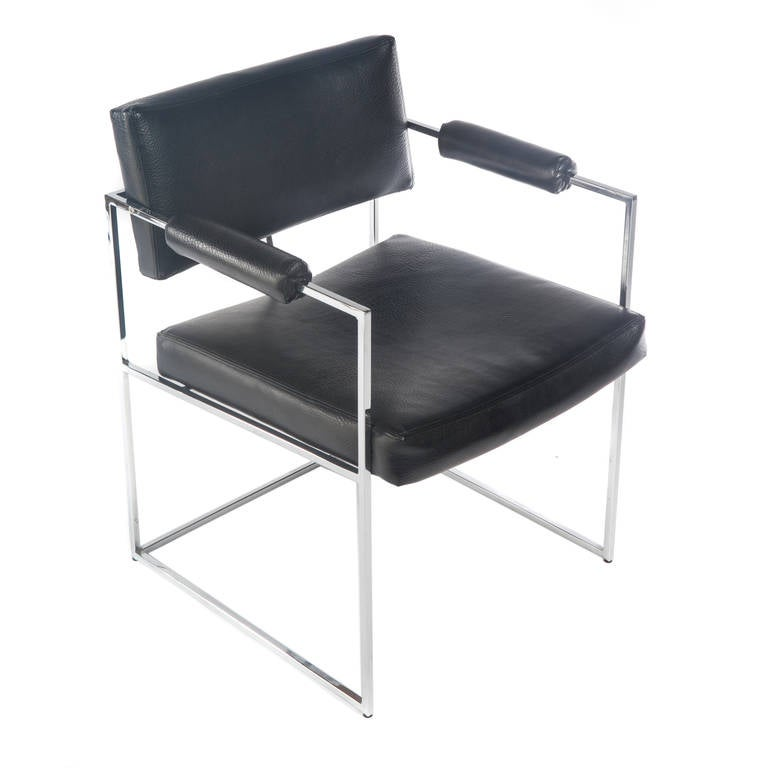 Two armchairs featuring sturdy polished-chrome frames with seats and backs upholstered in original black vinyl, circa 1970s. Can be used as occasional chairs in a seating group or as dining chairs. Signed with Thayer Coggin tags. 23
