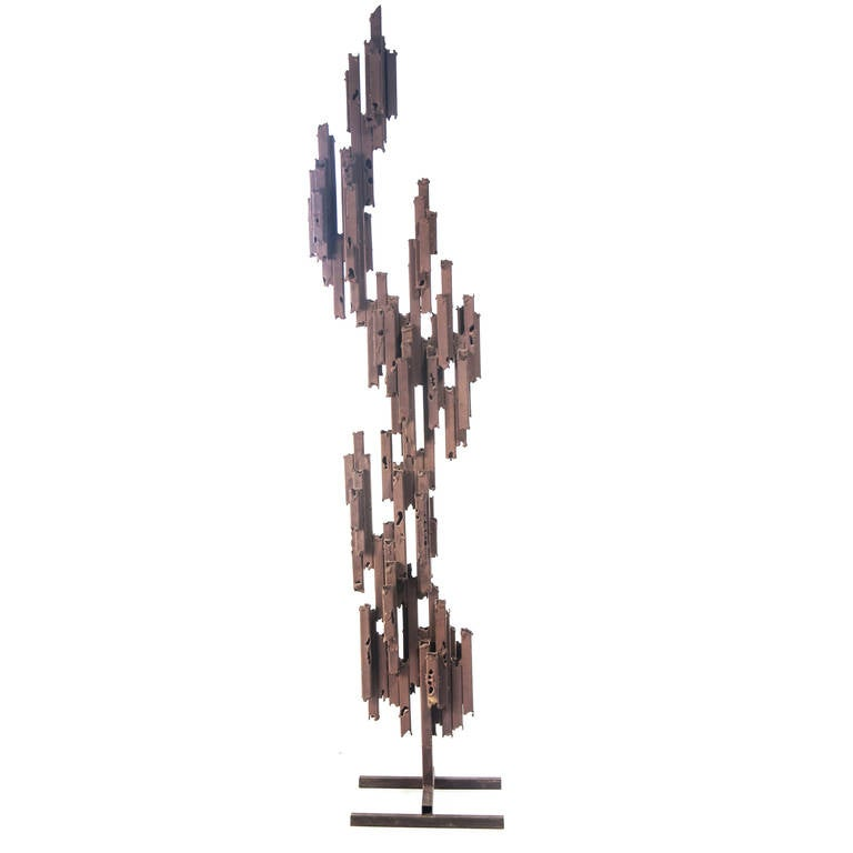 Large and dramatic abstract form consisting of square tubular steel welded into a stacked and interlocking formation. Heavy applied rust patina. Reminiscent of Marcello Fantoni but not signed. A statement piece. The sculpture itself is 76-1/2