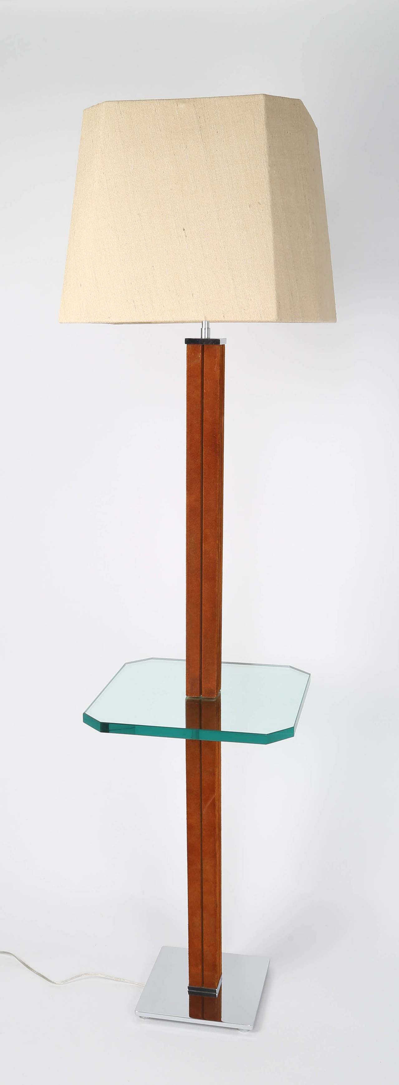 Gorgeous 1970s lamp table by Karl Springer features a stem wrapped in tobacco-brown suede supporting a 3/4