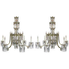 Pair of Regency Six-Arm Brass and Crystal Chandeliers