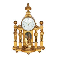 Large Neoclassical style French giltwood mantel clock with enamel dial