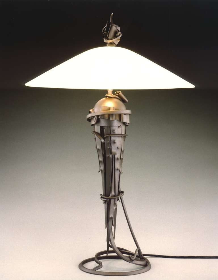 ALBERT PALEY (born 1944) Comet Table Lamp, 1999 Formed and fabricated carbon steel, glass shade 25 x 15 inches Signed, dated and numbered at base Edition of 20   Albert Paley, an active artist for over forty years at his studio in Rochester, New