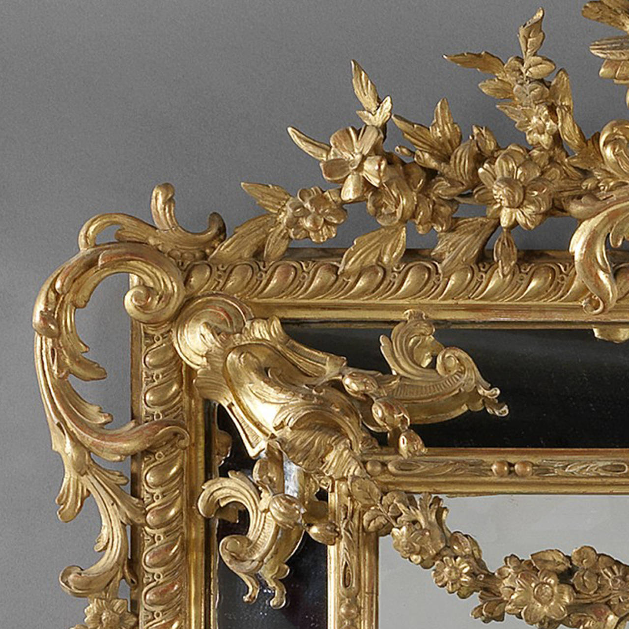 A Large and Finely Carved Louis XVI Style Marginal Frame Giltwood Mirror.    The bevelled rectangular mirror plate is framed by marginal side plates within a beaded and egg and dart carved rectangular giltwood frame with out-set corners and