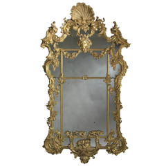 A Carved Giltwood Rococo Mirror after Thomas Johnson, Circa 1820