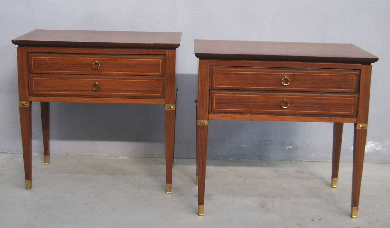 Elegant pair side tables matching with the sideboard. Brass details and brass sabots.