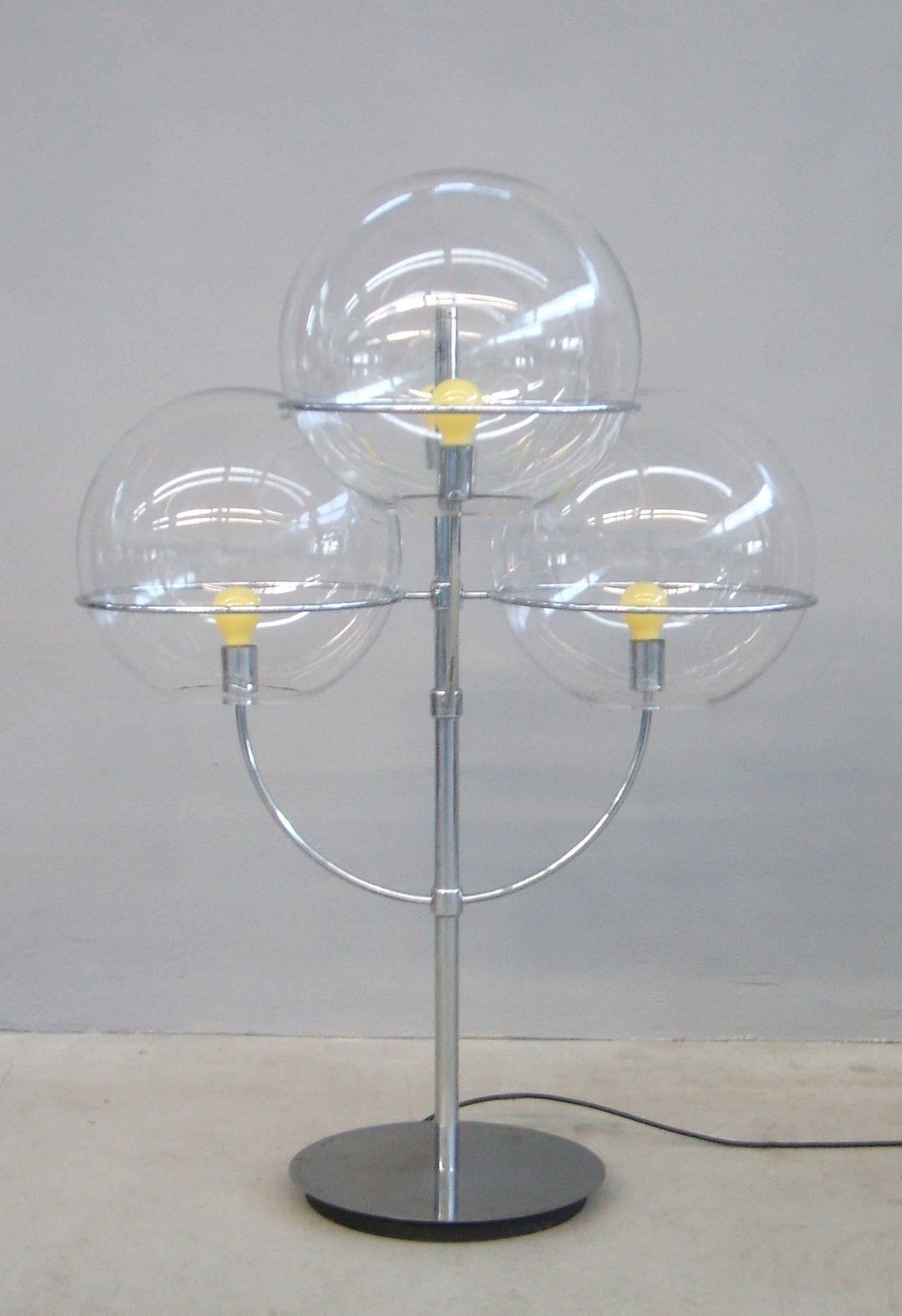 Mod 399 Lindon de sol designed by Vico Magistretti. Chrome steel and four glass reflector. Repertorio 1950-1980 pag. 450.