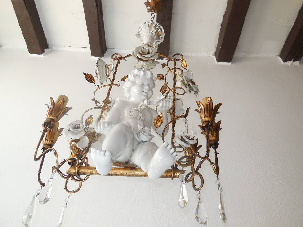 French porcelain roses and tole with huge cherub swinging chandelier french porcelain roses and tole with huge cherub swinging chandelier in excellent condition for sale in arubaitofo Choice Image