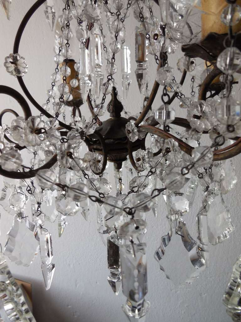 Housing 4 lights sitting in crystal bobeches, dripping with crystal balls.  Swags of crystal and florets throughout.  Blown Murano top.  Re-wired and ready to hang!  Free priority shipping from Italy.