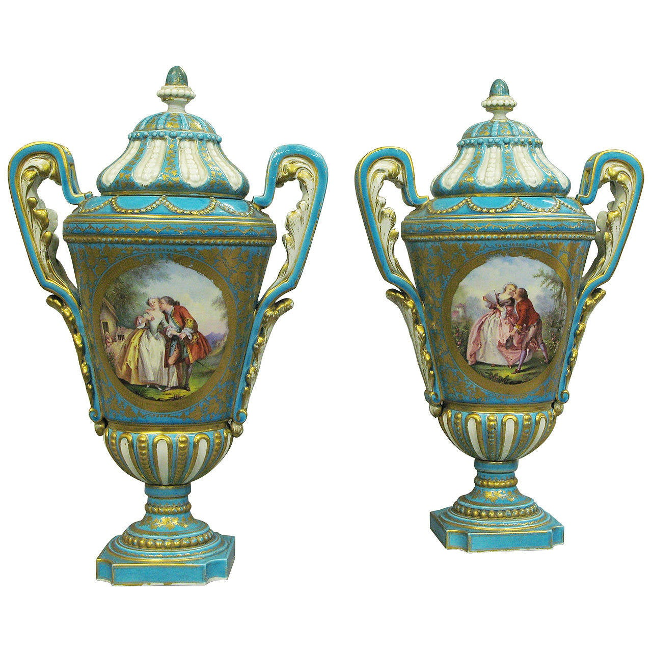 Pair of 19th Century Blue Ground Sevres Vases and Covers