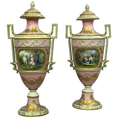Pair of 19th Century Sévres Pink Ground Vases and Covers