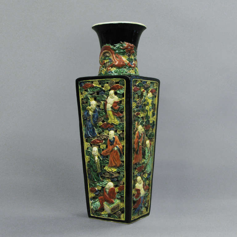A famille verte vase of square tapering form the side panels pierced with figurative scenes