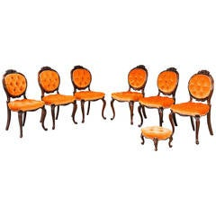 Six Single Chairs and a Stool