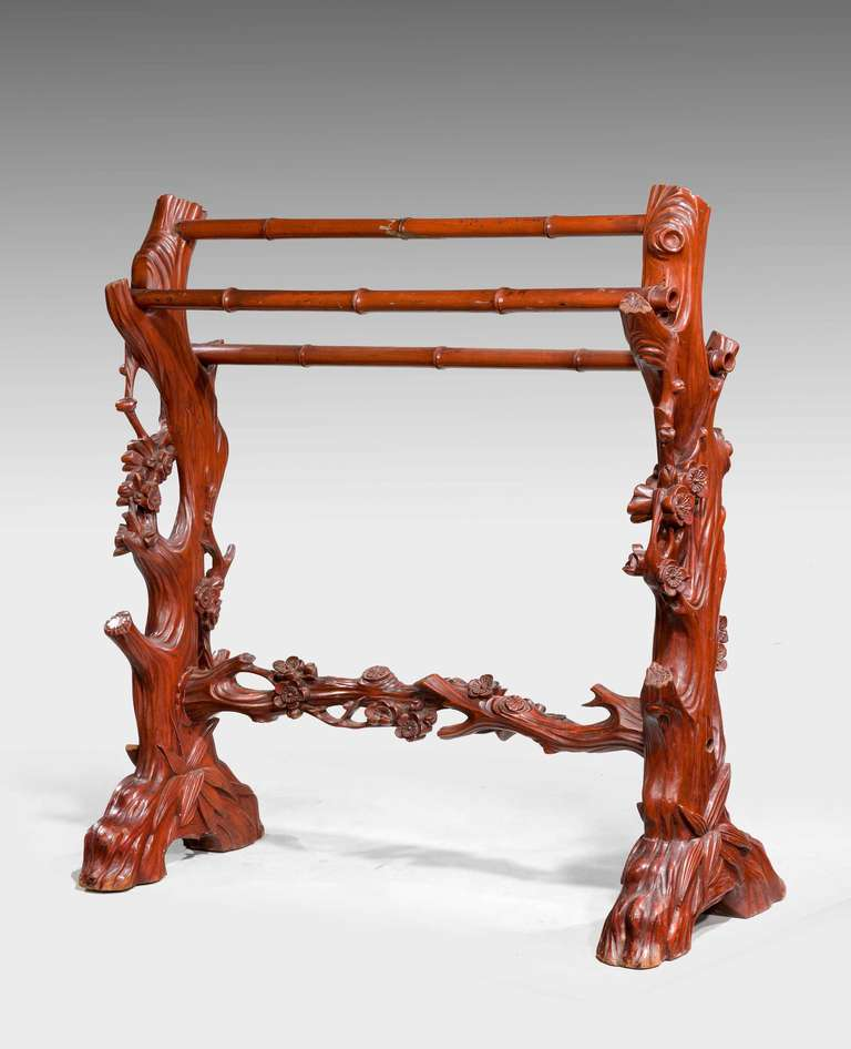 An unusual 19th century carved mahogany towel rail in the form of tree trunks with floral embellishments. Sturdy construction.