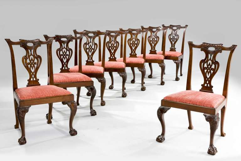 An outstanding set of eight early Chippendale period mahogany chairs of exceptional color and patina. The backs with strongly accentuated ears and finely carved and pierced upright splats, the cabriole supports with acanthus leaves to the knees