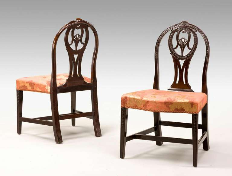 A good pair of George III Irish mahogany Chairs, the lancet shape back with well executed carved decoration, incorporating anthemia, harebells and wreaths. Please note there are two pairs for sale separately.