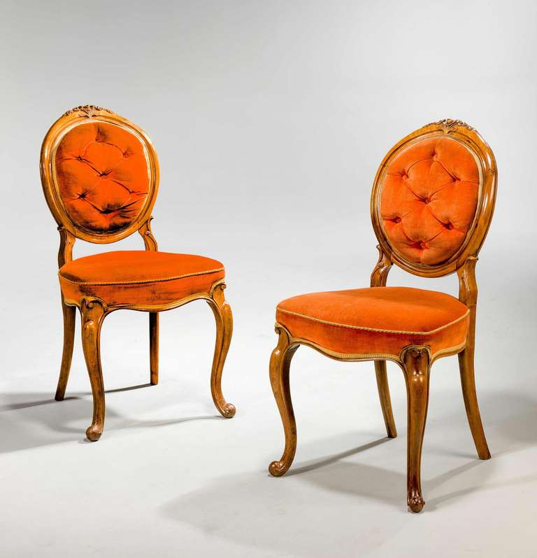 Set of six 19th century satin birch single dining chairs, the oval upholstered backs surmounted with applied carved decoration.  RR.