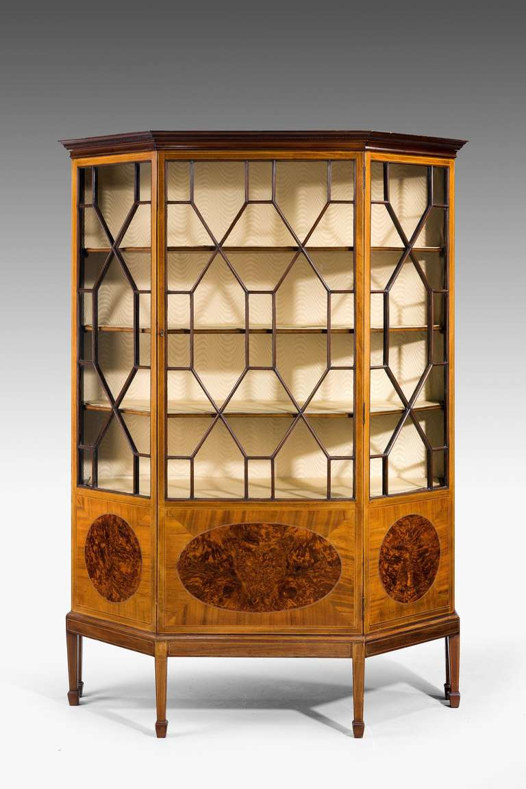 A very pretty Edwardian period mahogany display cabinet with off set side panels, quartered doors framing finely figured panels.