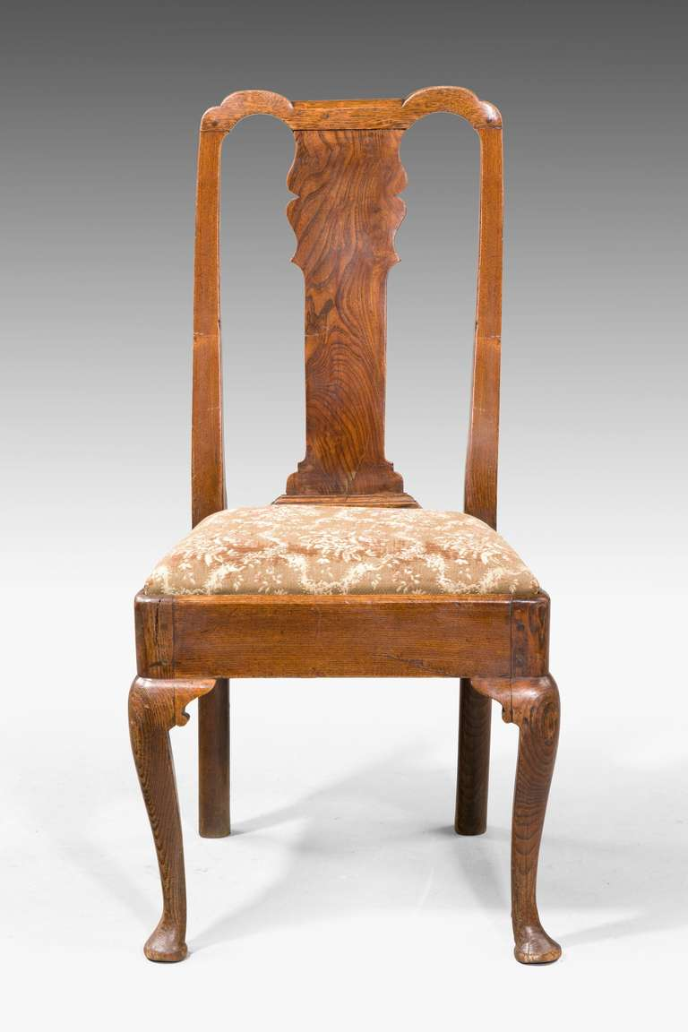 British Set of Four George I Period Elm Chairs For Sale