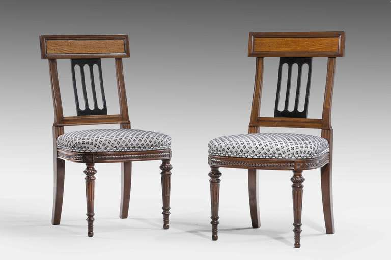 Fine set of ten 19th century mahogany and satinwood dining chairs, the bowed seat rails with continuous scrolled border over turned and incised supports in excellent condition, overall very fine quality.