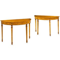 A Pair of Titchmarsh & Goodwin Satinwood Demi Lune Pier Tables