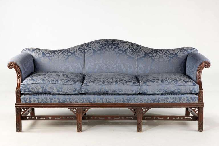 A Fine Quality Chippendale Style Mahogany Framed Camel Back Sofa With  Scroll Arms Over Well Carved