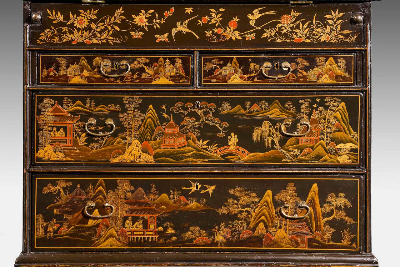 A very fine and rare Chinese lacquered writing bureau, made in the first quarter of the 18th century for the European market. Wonderful original condition. Including all the brassware. The scenes of grand oriental mountains, pavilions and figures.