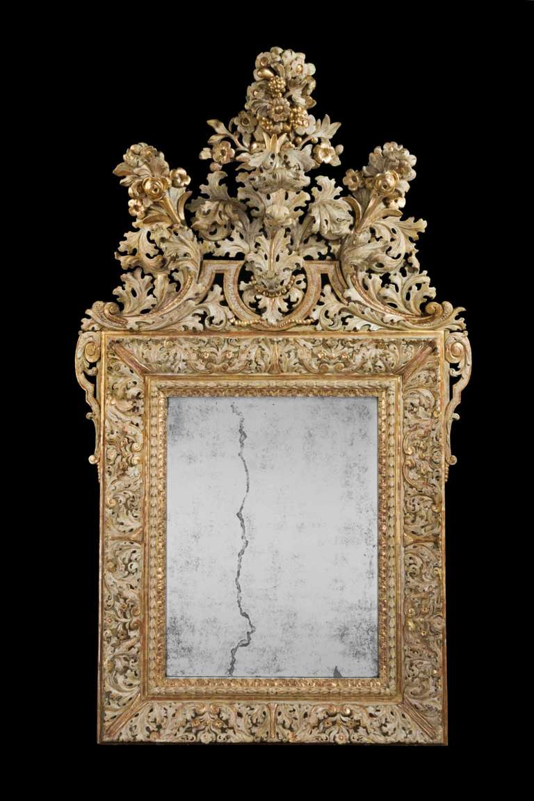 Magnificent early 18th century Swedish mirror, well carved giltwood decoration probaby from the Buchardt Precht workshops.  Buchardt Precht was a sculpture, educated in Hamburg, Germany. in 1674 Buchardt Precht moved from Sweden where he worked