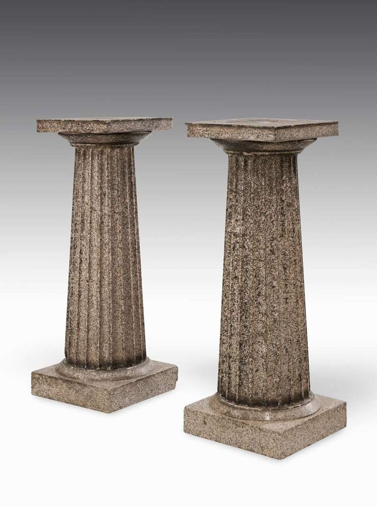 A good pair of Regency period granite pedestals in three sections, some weathering but in overall good condition.  RR.