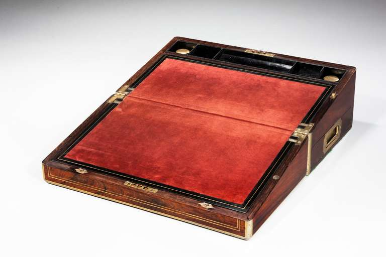 19th century period brass bound writing box with inset velvet interior slope and two fitted ink bottles.