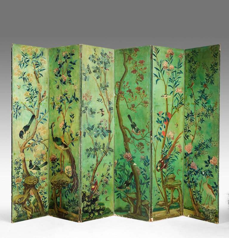 Well painted six fold screen, the decoration of exotic birds and flowers, oils on canvas dating from the mid-19th century.