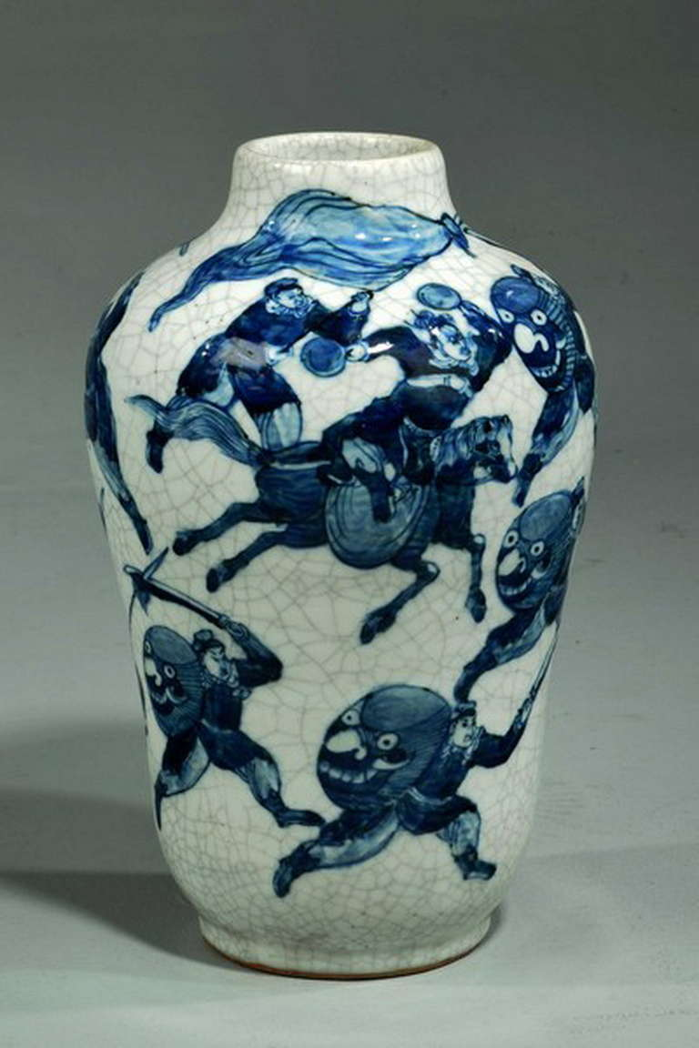 19th century blue and white Chinese vase depicting warriors on foot and on horse. In a crackle finish.