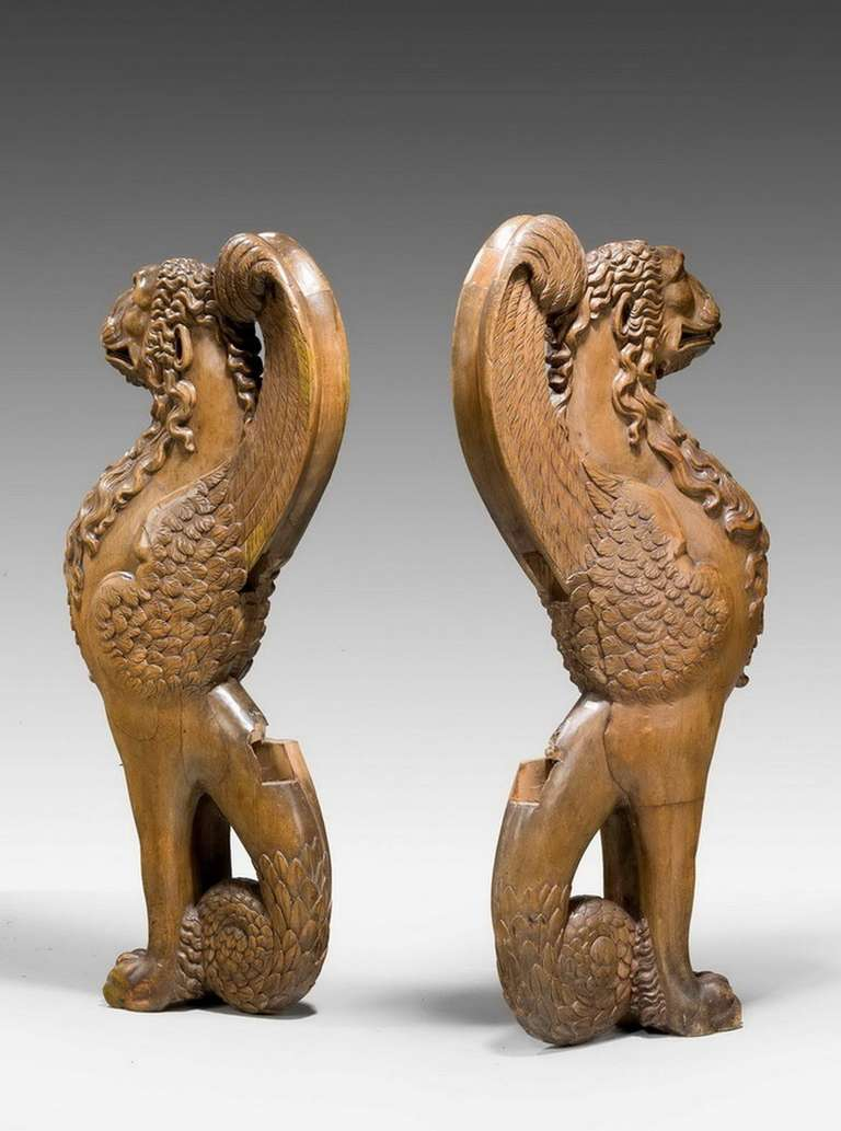 Pair of 16th century French walnut chimeras, vigorously carved with cut insets where the original seat would have been. Would make an imposing peer table or bench.