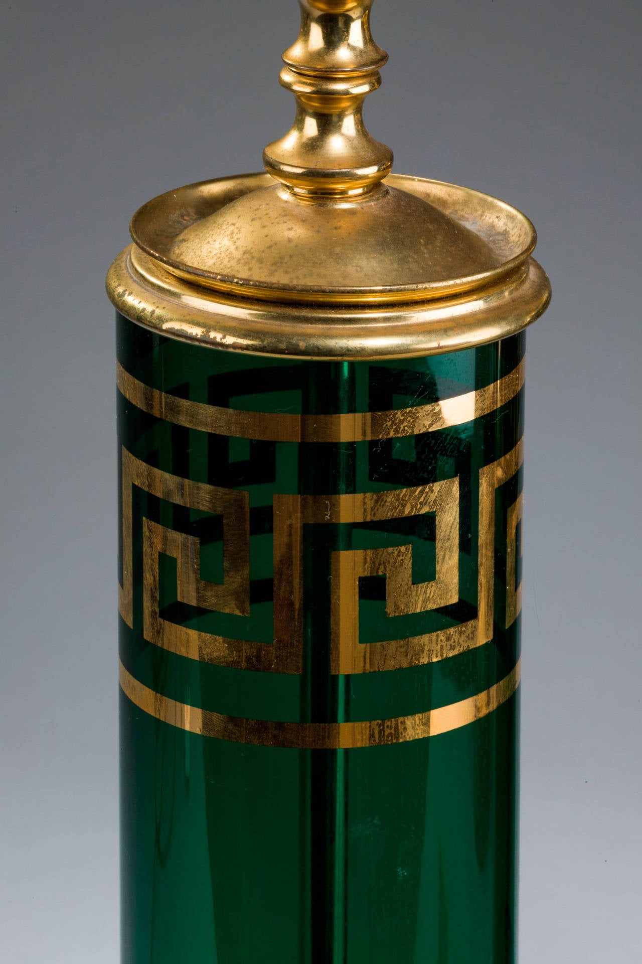 Pair of enamelled green glass lamps with Grecian key gilded decoration, original gilt metal mounts.  RR.
