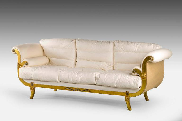 A Regency style giltwood sofa. On sabre supports, the uprights with well defined carved sections.  To await clients choice of material.  RR.