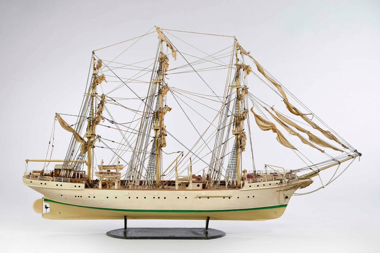 A good model of a model ship, the sails and rigging all original. The paint work somewhat tired however overall in good condition, dated from the mid-20th century.