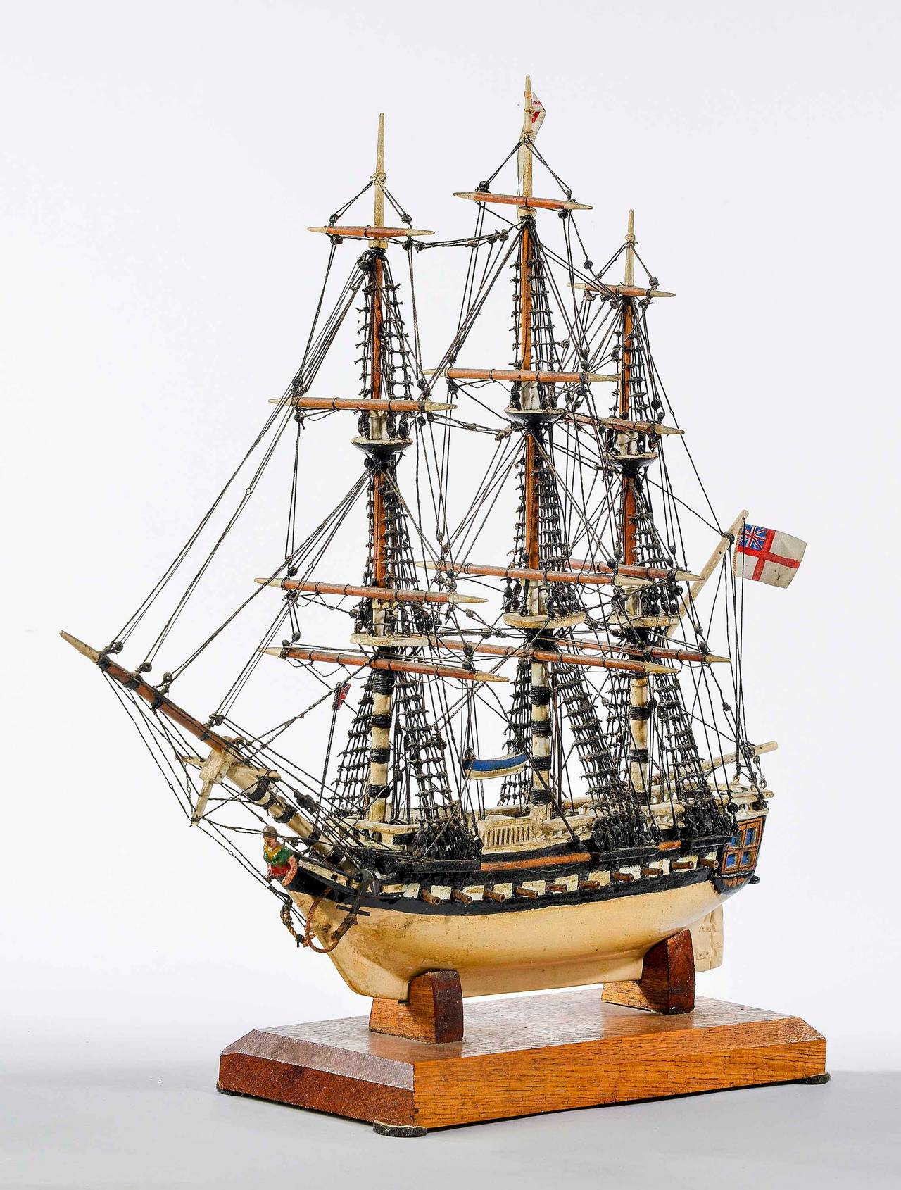 A fine ship model with particularly intricate rigging, which is original. Paintwork somewhat tired but an interesting complex model on an oak plinth.