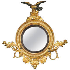 Regency Period Convex Mirror with a Rocaille Pediment Surmounted with an Eagle