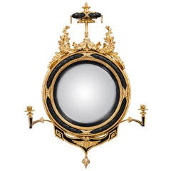 Regency Period Convex Mirror with Ebonised and Giltwood Decoration