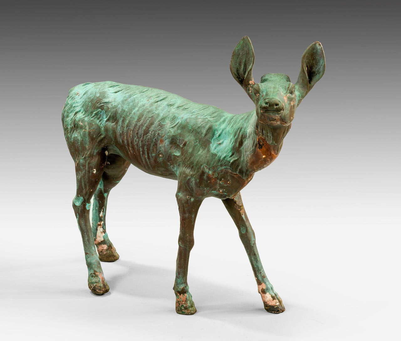 A charming cold cast bronze figure of a fawn. Well patinated to various shades of green and brown.