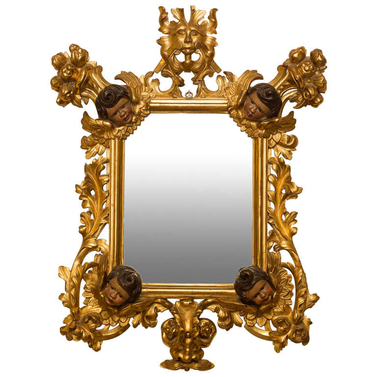rococo mirror with polycrome angels