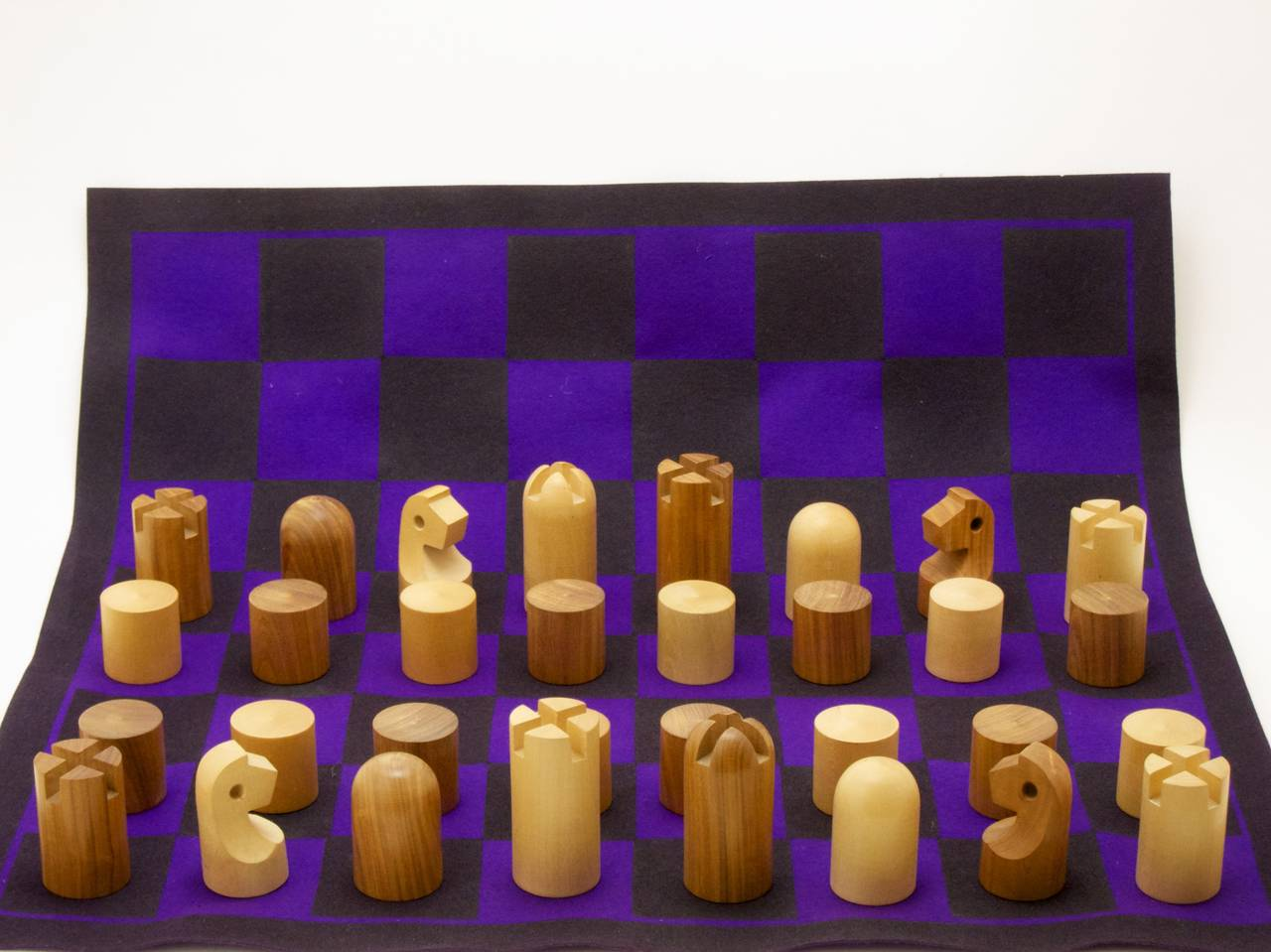 Rare, Minimalist wooden chess set by Carl Auböck comes with a purple felt