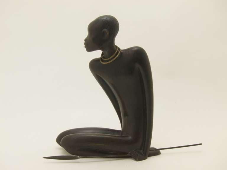 African Hunter with a Spear  Cast bronze, patinated  marked: Hagenauer logo, Hagenauer Wien, made in Vienna Austria.