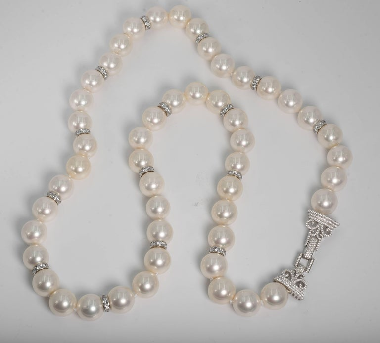 Our handmade Art Deco styleAudrey Hepburn Style faux pearls are of exquisite quality closely resembling the color and sheen of the best of Mikimoto pearls. Freshly hand strung knotted with silk threads. This wonderful necklace is 36 inches long,
