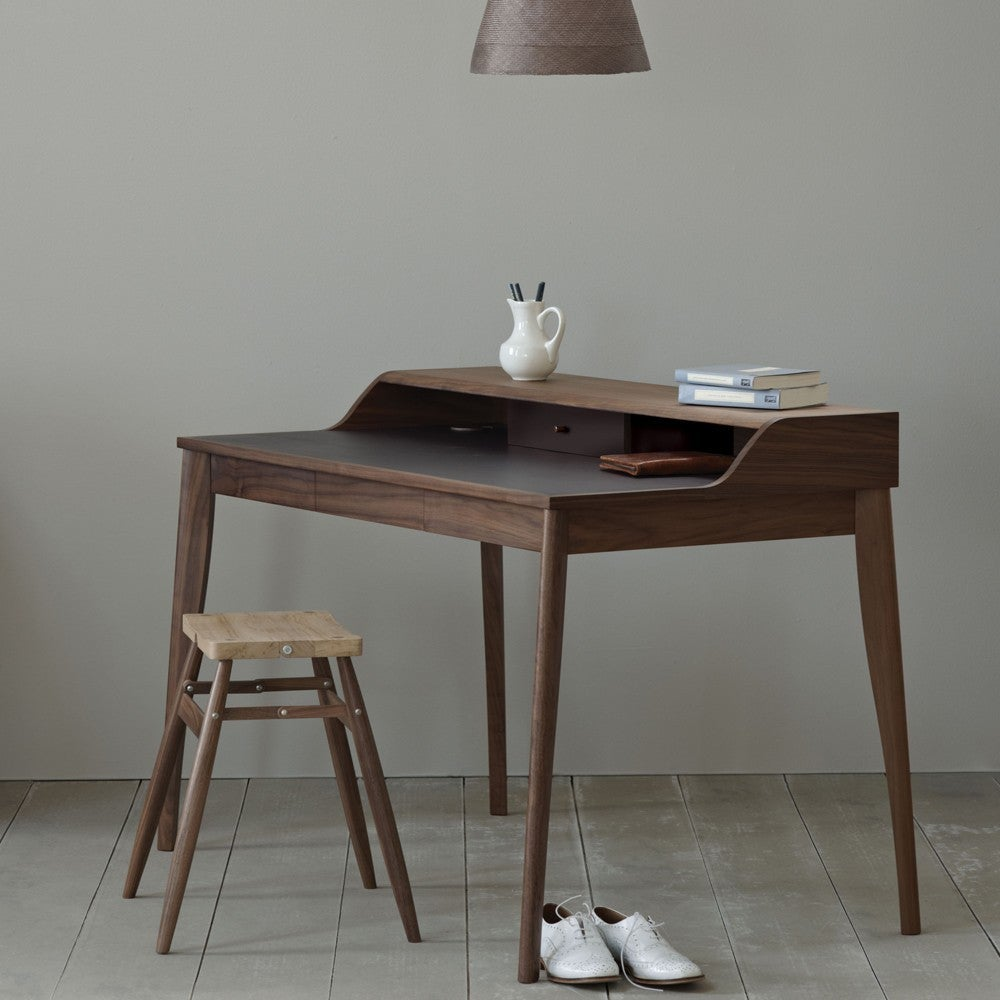 The Yves Desk Has An Inlaid Leather Writing Surface Two Drawers And Covered Cable