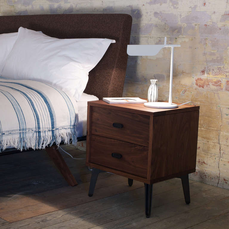 Designed by Matthew Hilton, the McQueen Bedside Chest is strong, elegant and down-to-earth, its two drawers provide the ideal space for objects needed close to the bed. Drawers are detailed with dovetail joinery, cast iron handles, and a soft-close