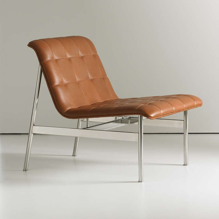 """The CP1 Lounge chair, designed by Charles Pollock, features a sleek design with a stainless steel frame and quilted seat and back.  27"""" W X 33.25"""" D X 28.5"""" H (Seat Height: 16.5"""")"""