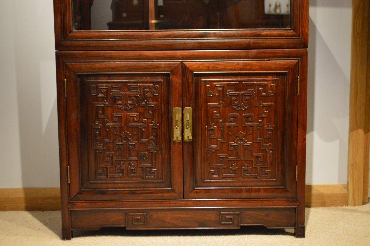 A Beautiful hardwood Chinese Antique Display cabinet. The upper section  with a hinged rectangular door - Hardwood Chinese Antique Display Cabinet At 1stdibs