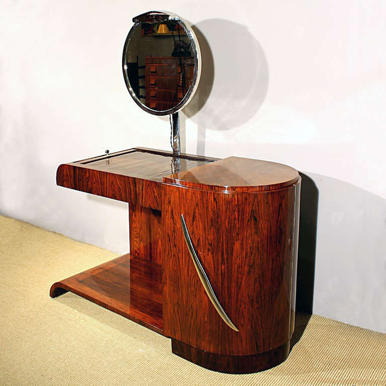 Exceptional Art Deco vanity, Rio rosewood veneer with a sliding blind on top and a big door on the front, swiveling luminiscent mirror and nickel plated brass handle, 4 sides completely finished. France circa 1930
